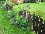 Utsidan staketet Här har jag en hel rad med Lupiner, som faktiskt börjat blomma så här på hösten. 2008-09-14 Bild 002